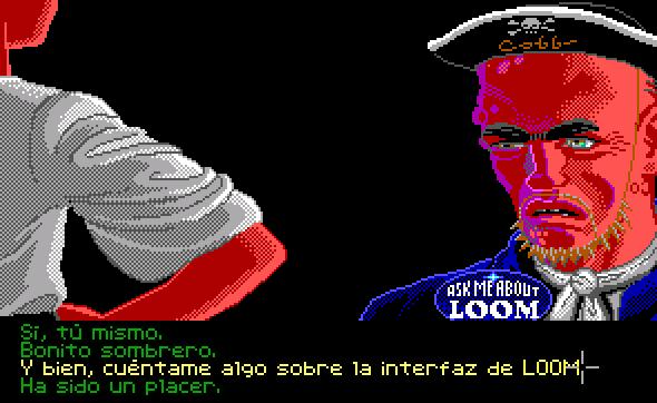 """Un chico de nombre impronunciable habla en una aventura gráfica con un pirata que lleva un sombrero en el que se lee Cobb y una chapa en la solapa en la que insta a que le pregunten sobre Loom. La opción de diálogo destacada es la siguiente: """"Y bien, cuéntame algo sobre la interfaz de Loom""""."""